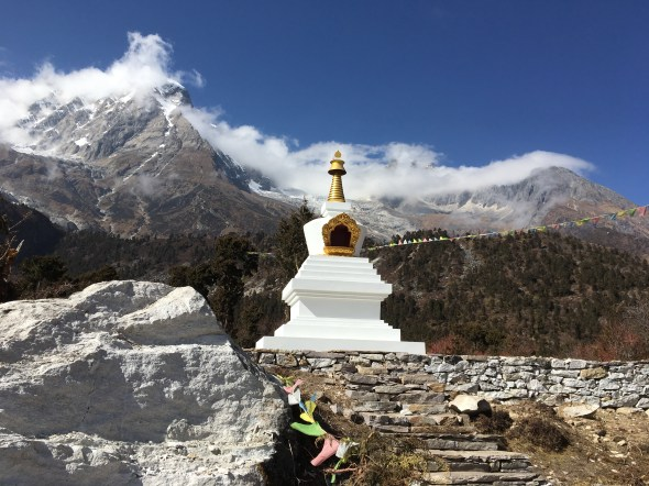 15. Stupa Surrounded by Mountains