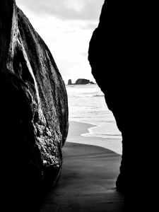 rocky formation on shore near ocean