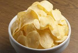 صورة رقائق البطاطس والافراط في تناولها يؤدي الى ظهور علامات خطيرة.