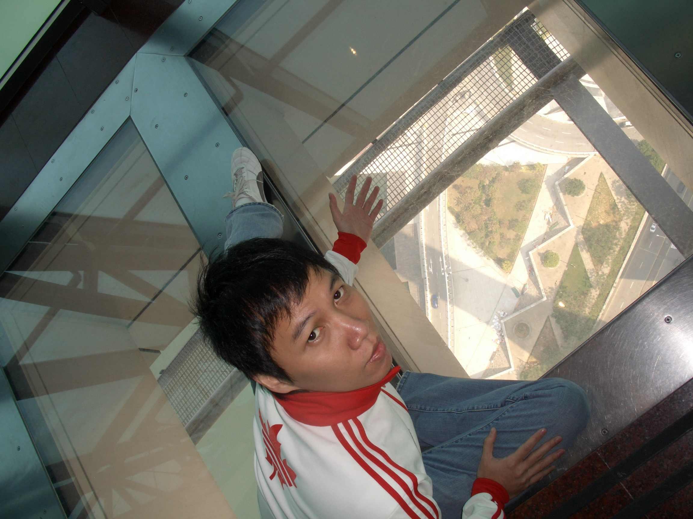 myself on the macau tower glass floor