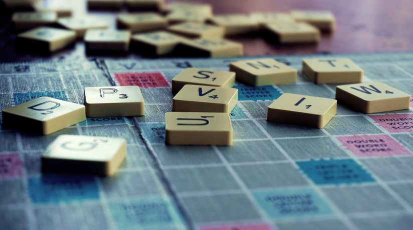 scrabble board game on shallow focus lens