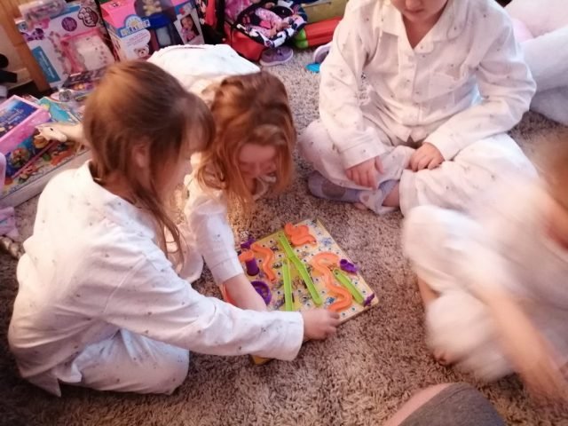 My girls playing the 3d version of the classic board game snakes and ladders.