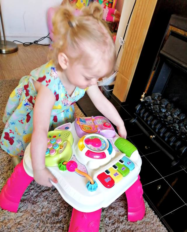 Another of Beast playing with her Vtech play and learn activity table.