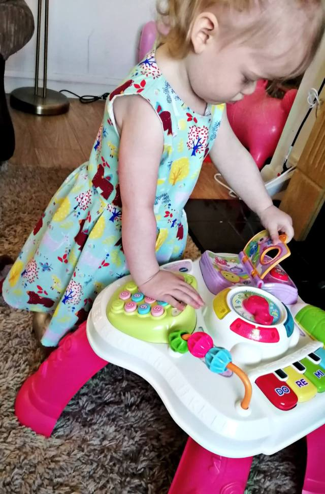 My youngest daughter playing with her Vtech play and learn activity table.
