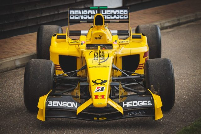 An image of the 2002 Jordan Honda EJ12 from the front end, Naked open fenders and historic F1 style diffuser.
