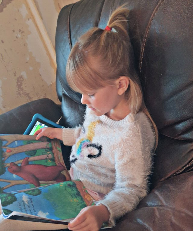 My daughter pig reading the rug bear. A great new children's story from writer Emma Rattray.