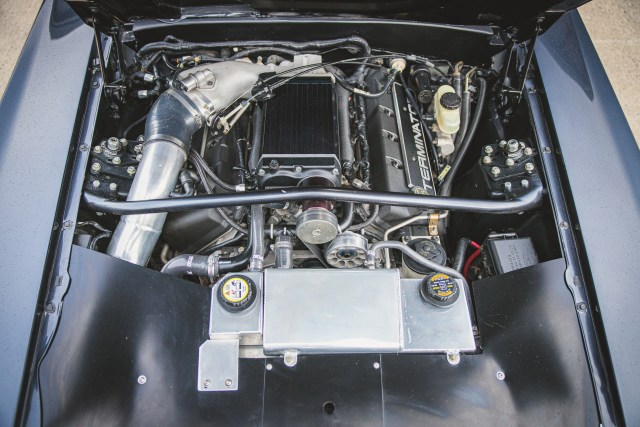 A view of the engine bay showing the beauty of this Restomod ford mustang.