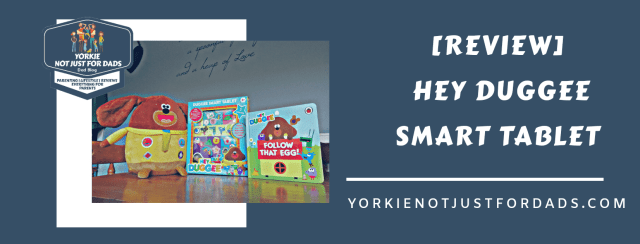 This is a graphic I created for this blog post review featuring a picture of the hey duggee smart tablet along side some of my youngest daughters other hey duggee toys.