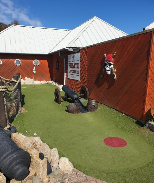 Perfect fun with the kids playing crazy golf, all about the Dad life wins.