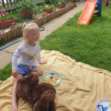 My youngest daughter Beast in the shade in our garden enjoying a Teddy bear Picnic. The shade is one way to help keep your baby cool this summer.