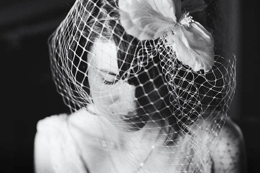 Bride in Birdcage veil before Scarborough Registry Office wedding. Black & White wedding photograph