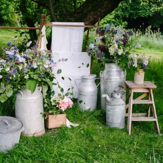 Milk churn arrangements