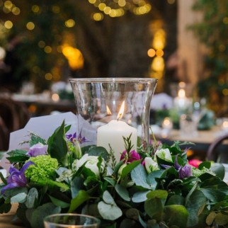 Photo: Lily North Photography. Table arrangements.