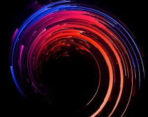 Swirl of blue, red, purple, and orange on black background