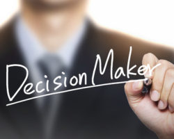 65776454 - decision maker written by hand, hand writing on transparent board, photo
