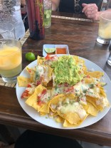 loaded nachos at desert night restaurant huacachina