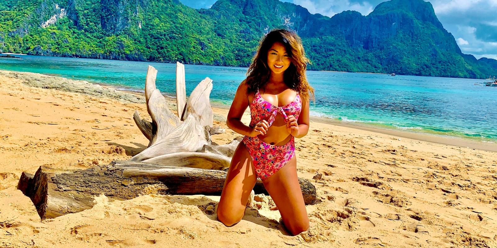 jenny chu in front of drift wood secret beach hidden beach matinloc shrine star beach helicopter island el nido philippines