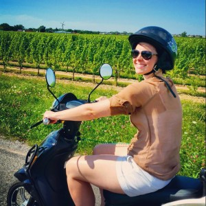 Profile image of blogger riding a scooter.