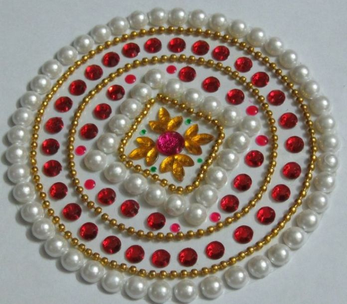 beautiful moti kundan rangoli design