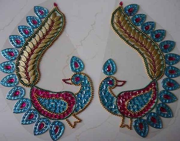 peacock kundan rangoli design