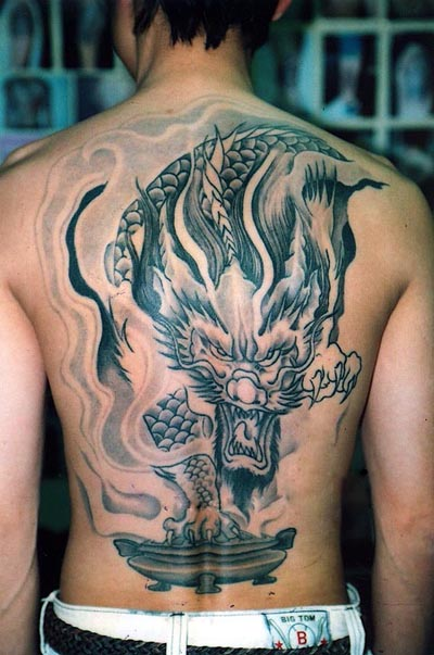 Tribal Raven Tattoo On Back For Men