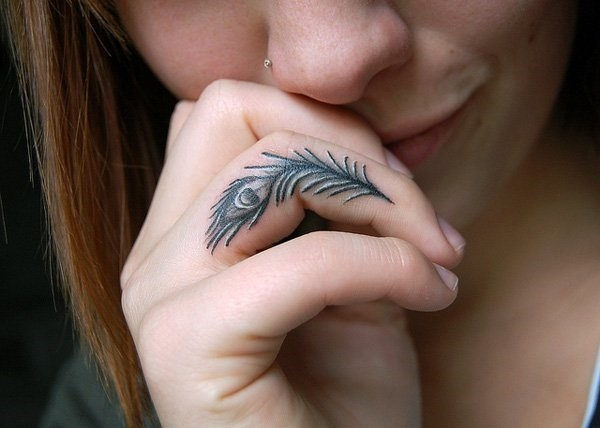 female finger tattoo