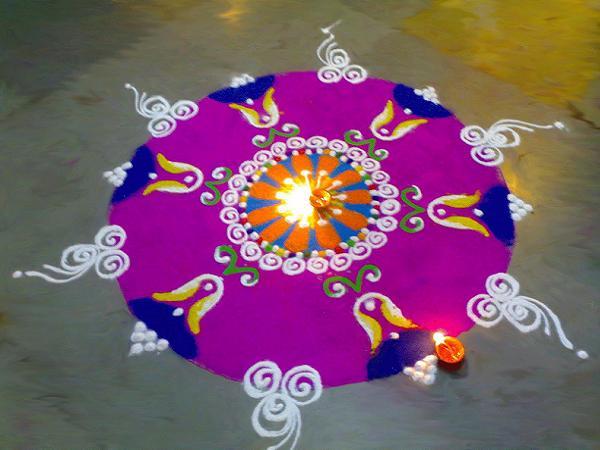 rangoli design with diya