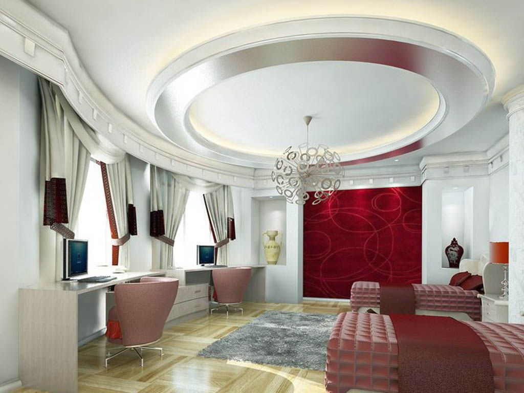 The Round Shaped Pop False Ceiling Looks Just Marvelous And The Light Coming Out Is Par Excellence The Furniture And Red Colored Wallpaper Is So Alluring
