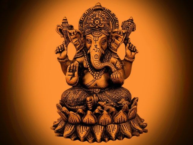 lord ganesha gold statue