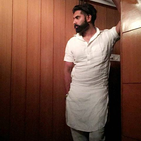 permish verma poses in white kurta pajama