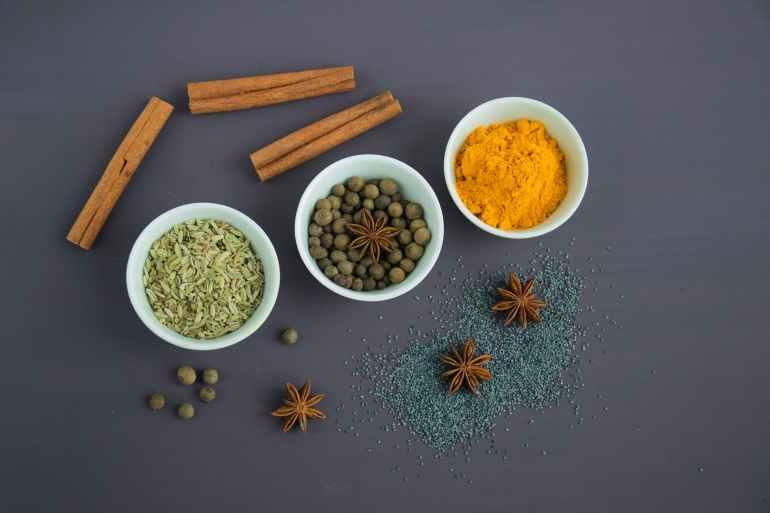 assorted spices near white ceramic bowls