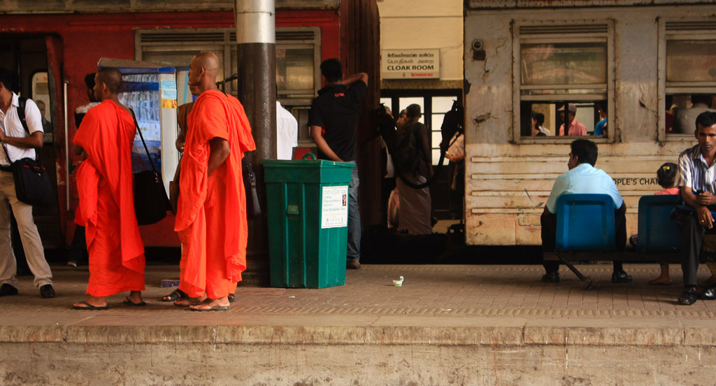 Buddhist monks at train station