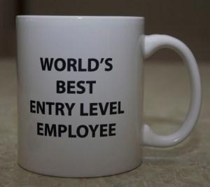 A drinking mug that reads,