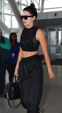 *EXCLUSIVE* New York, NY - Kendall Jenner is the definition of sporty chic as she departs JFK Airport wearing a mesh crop top, high waisted drawstring pants, leopard heeled boots, and a Givenchy bag. AKM-GSI September 30, 2016 To License These Photos, Please Contact : Maria Buda (917) 242-1505 mbuda@akmgsi.com sales@akmgsi.com or Mark Satter (317) 691-9592 msatter@akmgsi.com sales@akmgsi.com www.akmgsi.com