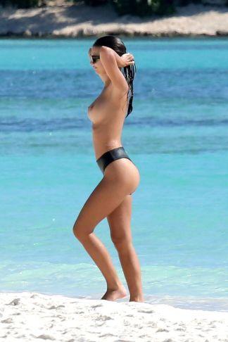 EXCL: Emily Ratajkowski hides the goods in Paradise
