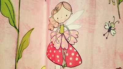 close up photo of pink and red fairy graphic textile