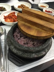 The inside had purple rice, which you scoop out, and then pour hot water into the mostly empty bowl to make Noo-roong-ji.