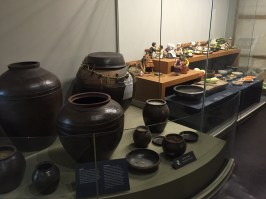 """Example of """"Jangdokdae"""", which is an outside space where a bunch of jars are gathered. Most often, these jars hold foods that are being fermented, such as dwaenjang or gochujang (soybean or red pepper paste). The jars are sometimes used to simply store foods for a long period of time as well."""
