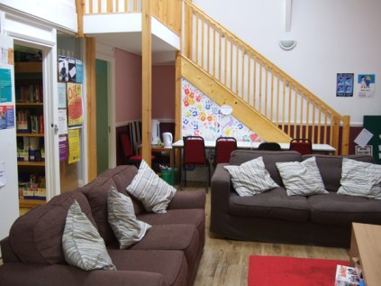 Image showing the YPC sofas and hand prints on the walll