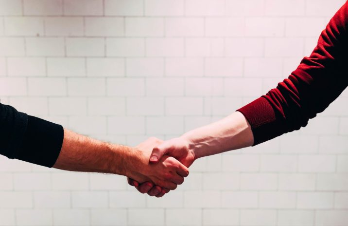 Shaking hands with a customer
