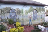 """Birding"", a mural on the Mural Walk in Lake Placid. Photo by Lucy Beebe Tobias, Authentic Florida Expert for VISIT FLORIDA."