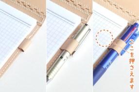 ペンホルダーは伸縮式なので、直径13ミリ位までのペンをお使いになれます。滑り止めのゴム付きのペンは、写真の丸印の辺りを押さえるとスムーズに出し入れできます。※ペンは付属しません。
