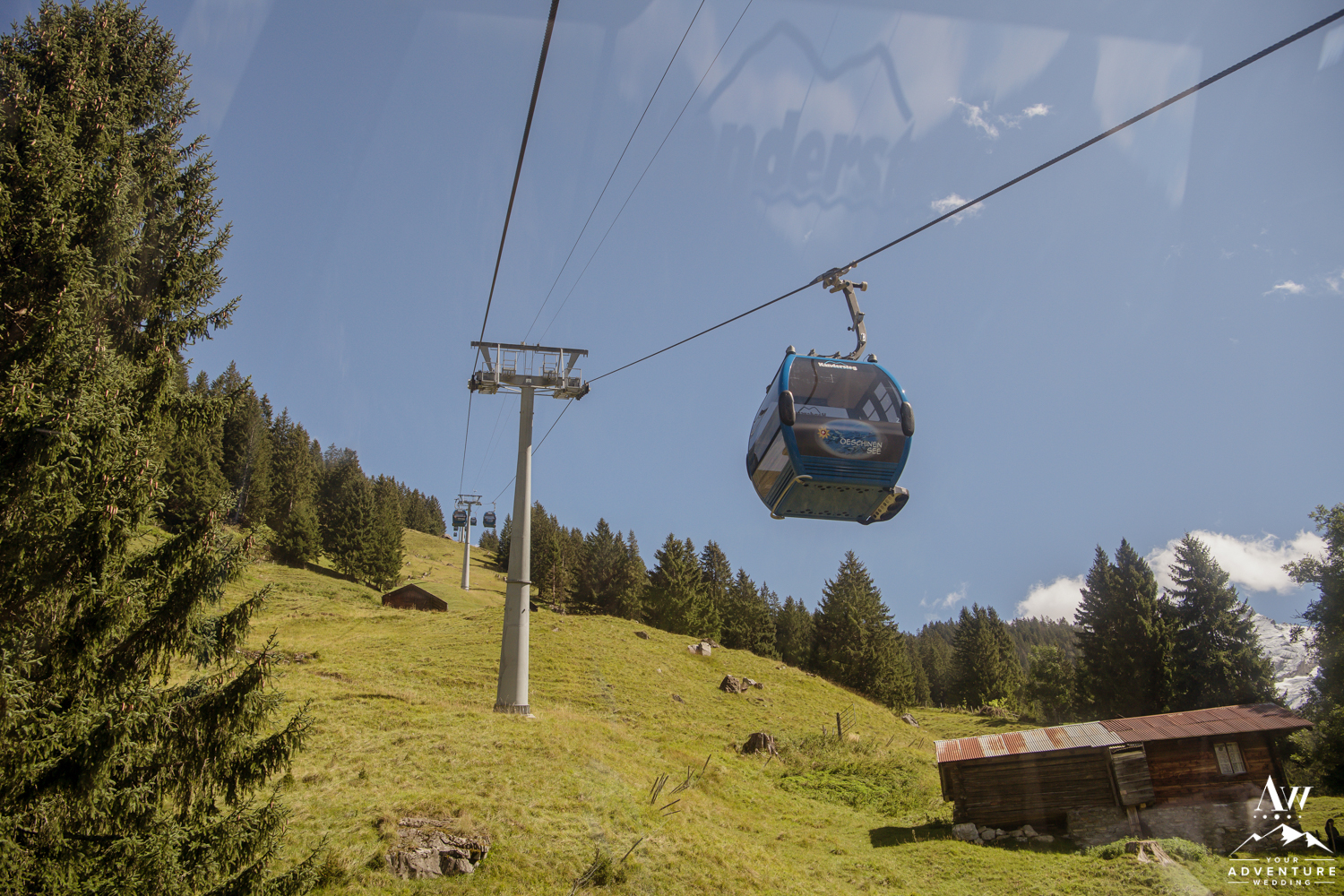 Wedding couple takes gondola up to oeschinensee