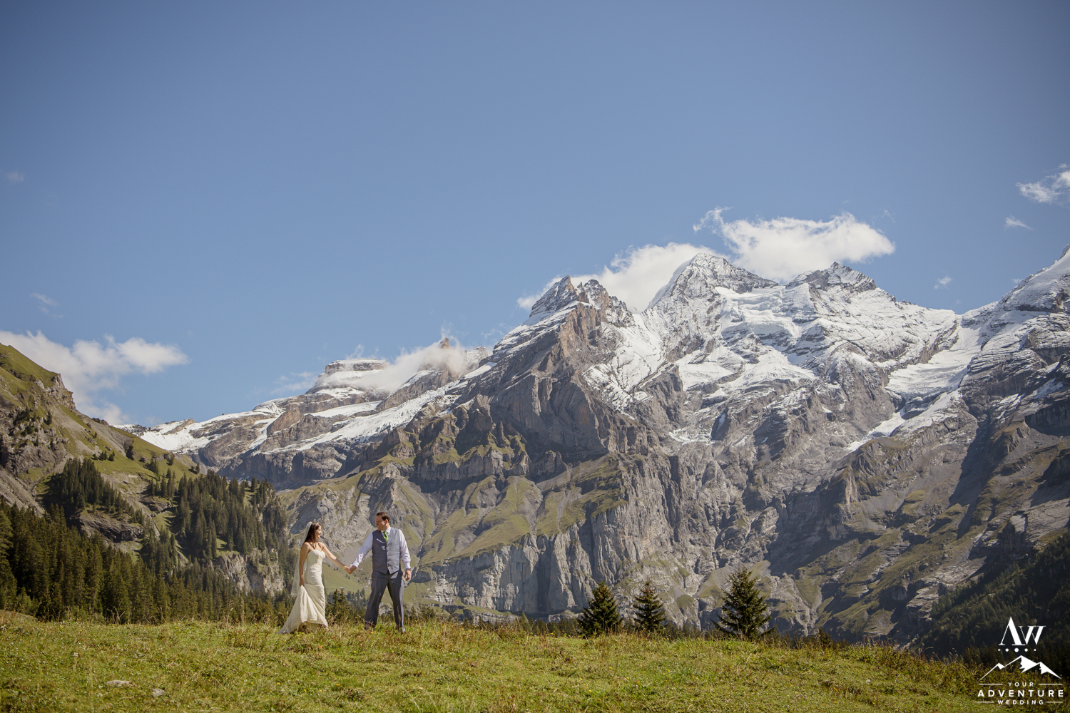 Couple adventuring on their wedding day in Switzerland
