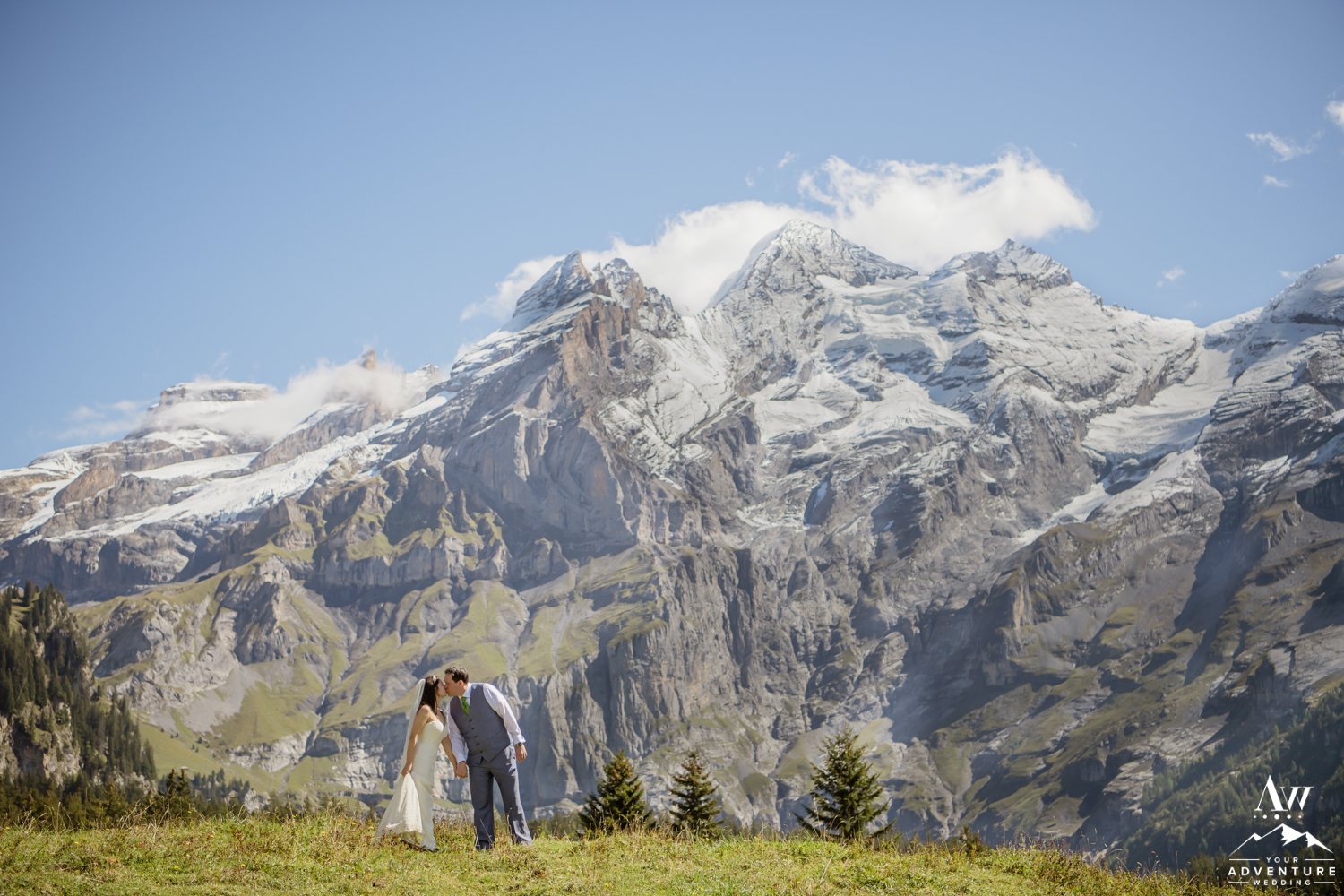 Couple kissing in front of the Alps in Switzerland