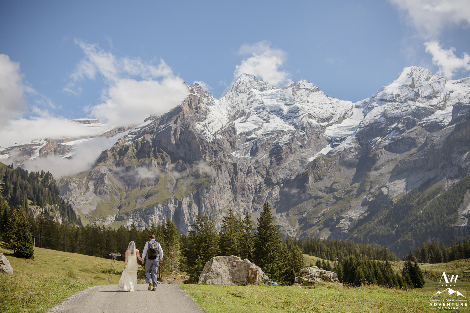 Couple hiking in the Swiss Alps on wedding day