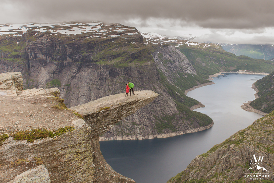 Couple at the top of trolltunga kissing during Norway elopement