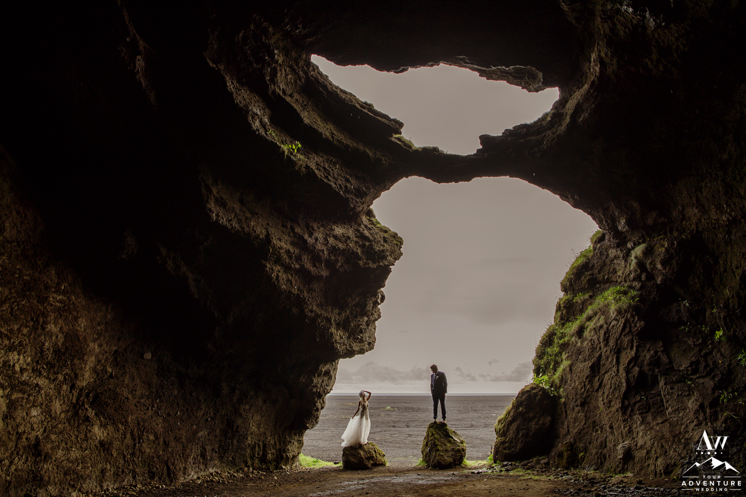 Couple inside of a cave during Iceland wedding day adventure