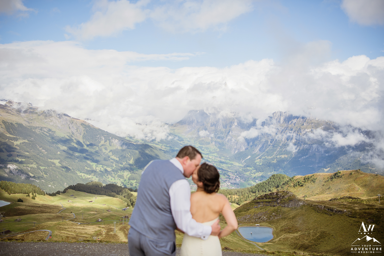 Switzerland wedding couple kissing on top of Männlichen