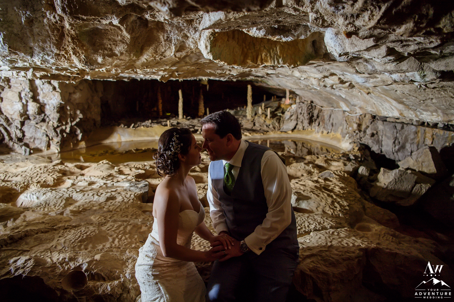 Couple Kissing in front of st beatus caves switzerland